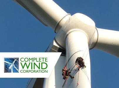 CWC techs climbing turbine blade